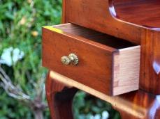 Drawer and brass knob.